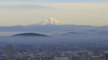 Portland OR Downtown Cityscape with Mount Hood at Sunset with Rolling Fog Panning Expansive View 1080p — Stock Video