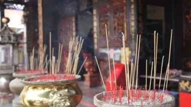 Burning Incense Joss Sticks for Blessings in Buddhist Temple 1080p — Stock Video