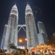 Постер, плакат: Holiday Decorations by Petronas Twin Tower at KLCC Park
