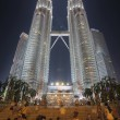 Tourists by Petronas Twin Towers at Night — Stock Photo