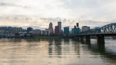 Portland Oregon Downtown Skyline along Willamette River with Hawthorne Bridge Moving Clouds and Water Reflection at Sunset Time Lapse 1080 — Stock Video