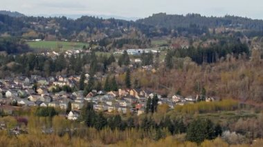 Panoramic View of Happy Valley Oregon Suburb Housing and Homes Nested in a Natural Scenic Landscape Panning 1080p — Stock Video