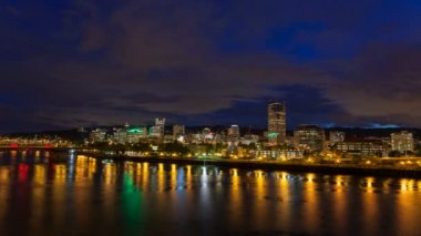 Portland Oregon Downtown Cityscape Skyline Bridges and Colorful Water Reflection along Willamette River with Moving Clouds and Sky at Blue Hour Time Lapse 1080p — Stock Video