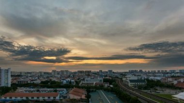 Time lapse zooming out movie of sunrise and moving clouds by Eunos MRT Station in Singapore. Eunos is a planned residential neighborhood east of the Central Area. 1920x1080 — Stock Video