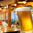 Glass of beer in beerhouse — Stock Photo