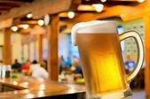 Glass of beer in beerhouse — Stock Photo