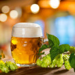 Hops and beer glass — Stock Photo