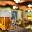Beer glass in pub — Stock Photo #31628957
