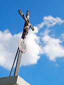 Old repairet Catholic cross — Stock Photo