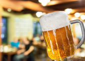 Beer glass in pub — Stock Photo