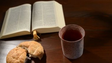 Bible with chalice and bread — Stock Video