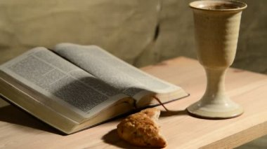 Bible with chalice and bread — 图库视频影像