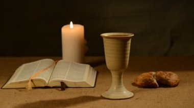 Flaming candle and chalice of wine — Stock Video