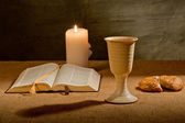 Chalice of wine and bible — Stock Photo