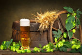 Beer Glass With Barley And Hop Cones — Stock Photo