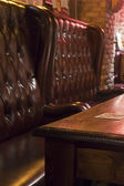 Wooden Table and Comfortable Seats in Pub — Стоковое фото