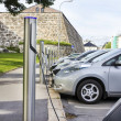 Electric car plugged in to electricity — Stock Photo #28331411