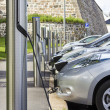 Stock Photo: Electric car plugged in to electricity
