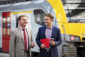 Two Businessmen at Railway Station — Stock Photo