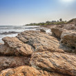 Tropical beach with waves crashing on rocks in West Africa — Stock Photo #40066607