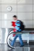 Walking person on walkway — Stock Photo