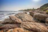 Tropical beach with waves crashing on rocks in West Africa — Stok fotoğraf