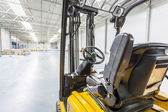 Forklift truck ready to use in modern storehouse — Stock Photo