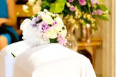 Wedding bouquet in the church on the table — Stock Photo