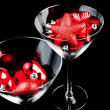 Red christmas decoration in the champagne glass — Stock Photo