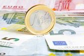 One euro coin on banknotes — Stock Photo