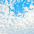 Stock Photo: Blue sky background with white clouds