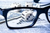 Dice on financial chart near dollars — Stock Photo