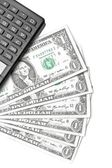 Top of view of dollars near calculator — Stock Photo