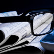 Glasses on financial newspaper — Stock Photo #31894931