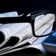 Stock Photo: Glasses on financial newspaper
