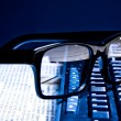 Glasses on financial newspaper — Stock Photo #31896499