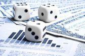 Dice on financial chart near dollars — Stock Photo
