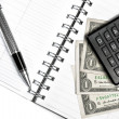 Calculator, dollars and business pen on notebook — Stock Photo