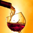 Red wine in the glass tilted — Stock Photo #34765005