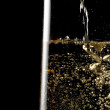 Flute of champagne with golden bubbles — Stock Photo #34765969
