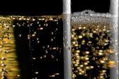 High detail of one flute of champagne with golden bubbles — Stock Photo