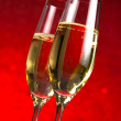 A pair of flutes of champagne red abstract background — Stock Photo