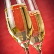 A pair of flutes of golden champagne — Stock Photo