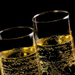 A pair of flutes of champagne with golden bubbles — Stock Photo