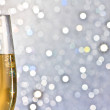 One flute of golden champagne on abstract background — Stock Photo #35553911