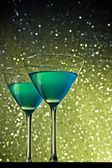 Glasses of blue cocktail on table — Stock Photo