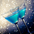 Two glasses of blue cocktail on table — Stock Photo #36039877