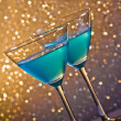 Stock Photo: Two glasses of blue cocktail on table