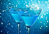 Detail of a pair of glasses of blue cocktail on table — Stock Photo