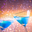 Two glasses of  fresh blue cocktail with ice make cheers — Stock Photo